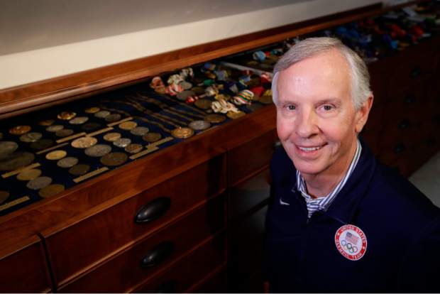 Gordy Crawford poses at his home with some of his Olympic medals and pins in La Canada Flintridge, Calif on Aug. 14. Parts of the collection will eventually go on display at the U.S. Olympic Museum, now under construction in Colorado Springs and expected to open in 2020.