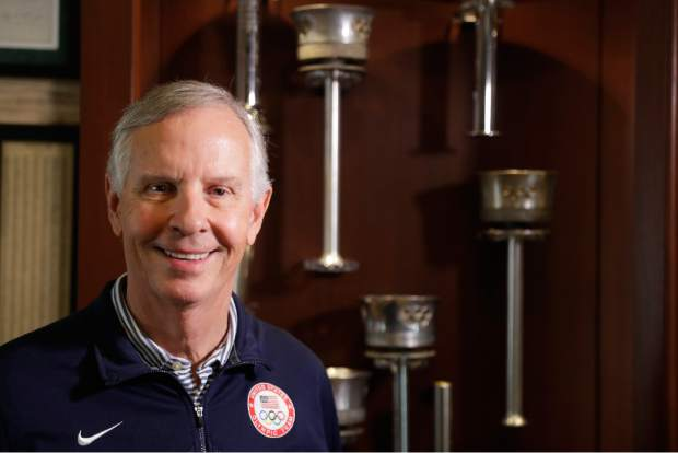 Gordy Crawford poses at his home with some of his Olympic torches in La Canada Flintridge, Calif on Aug. 14. Parts of the collection will eventually go on display at the U.S. Olympic Museum, now under construction in Colorado Springs and expected to open in 2020.