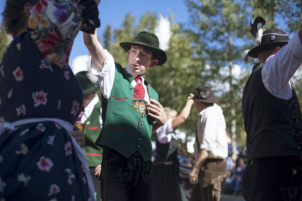 Trachten Erhaltungs Verein Edelweiss club's, Micah Wright, and other members perform the traditional german dance during the Breckenridge Oktoberfest event Friday, Sept. 7, at the Blue River Plaza.