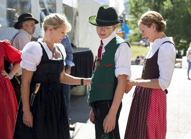 Trachten Erhaltungs Verein Edelweiss club members, of Morrison, from left, Brigitte Johnson, Micah Wright, and Brenda Wright, prepare their traditional german costumes during the Breckenridge Oktoberfest event Friday, Sept. 7, at the Blue River Plaza.