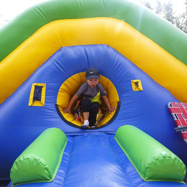 A boy exits a toddler bounce house Saturday, Sept. 1, at the Blue RIver Plaza in Breckenridge.