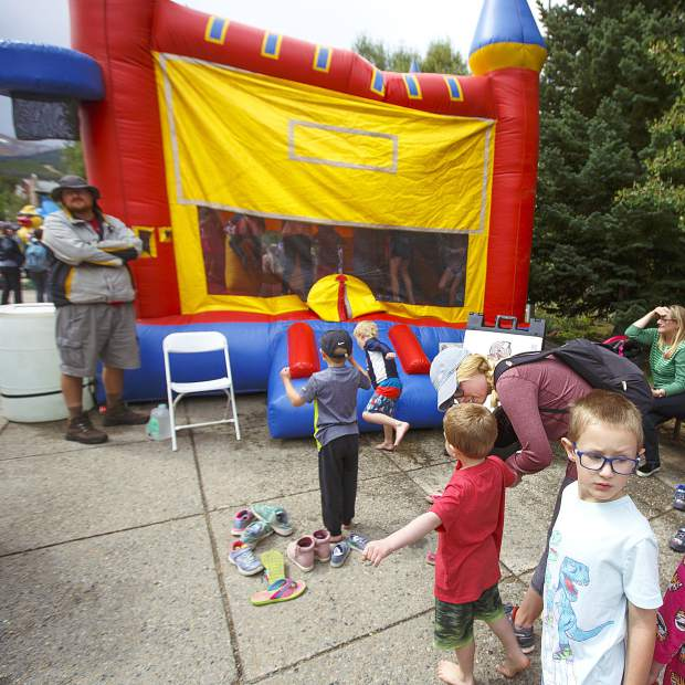 Children line up for the bounce house Saturday, Sept. 1, at the Blue RIver Plaza in Breckenridge.