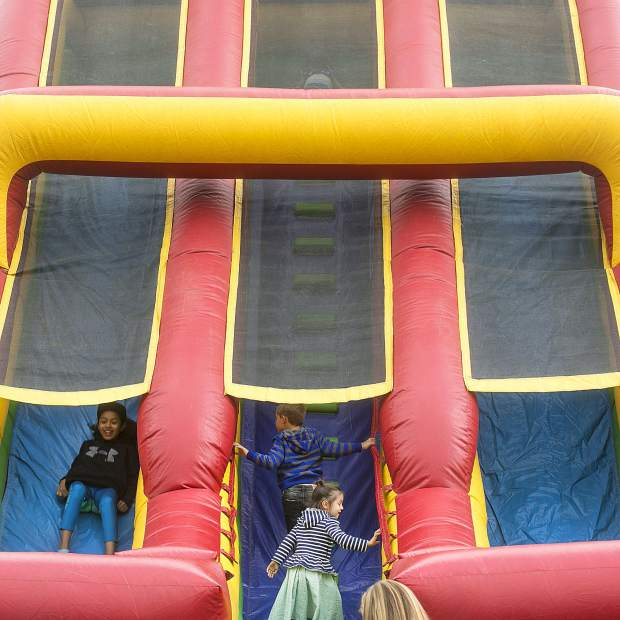 Children interact with large inflatable slide Saturday, Sept. 1, at the Blue RIver Plaza in Breckenridge.