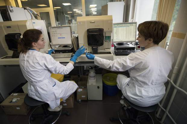 In this May 2016 file photo, employees work in Russia's national drug-testing laboratory in Moscow. Russian doping whistleblower Grigory Rodchenkov, the whistleblower who exposed Russia's doping corruption at the Sochi Olympics, added to a chorus of protest over the possible reinstatement of the country's anti-doping agency. In a statement provided to The Associated Press, Grigory Rodchenkov portrayed the World Anti-Doping Agency's shifting of its requirements to end RUSADA's suspension as a result of Russia's unwillingness to accept findings from investigator Richard McLaren, who detailed a government-sponsored doping program designed to win medals.