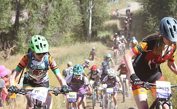 Summit Tigers freshman Marin Ward (left) races during Sunday's Showdown In the Boat mountain bike event in Steamboat Springs, the second event of the 2018 Colorady High School Cycling League season. Ward finished in seventh place in the 2-lap freshman girls race.