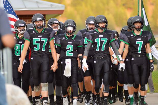 The Summit High School varsity football team walks out of the locker room before their victory over Steamboat Springs last fall, by the score of 24-3 on Sept. 1, 2017.