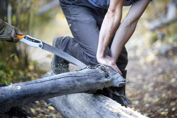 Summit Fat Tire Society volunteers cut discarded logs for trail maintenance Thursday, Sept. 20, on the Peaks Trail near Frisco.