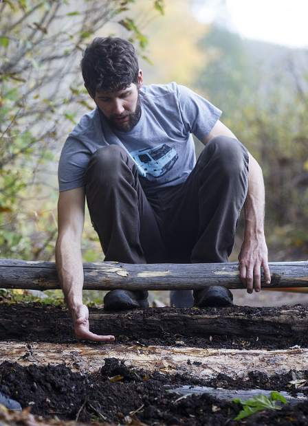 Summit Fat Tire Society vice president Ben Ferrante designs the log step portion of the trail to improve climbing and descending for hikers and mountain bikers on the Peaks Trail Thursday, Sept. 20, near Frisco.