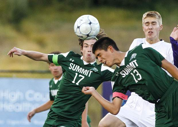 Summit High School senior Angel Rios heads the ball during the game against Salida High School on Thursday at Tiger Stadium in Breckenridge. Summit won 2-0.