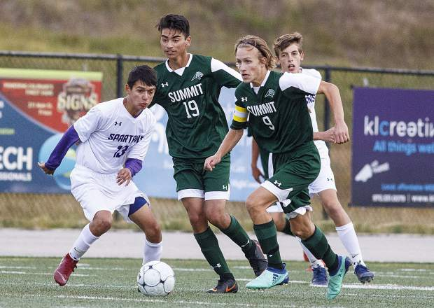 Summit High School senior midfielder Evan Wolfson dribbles the ball during the game against Salida High School on Thursday at Tiger Stadium in Breckenridge.