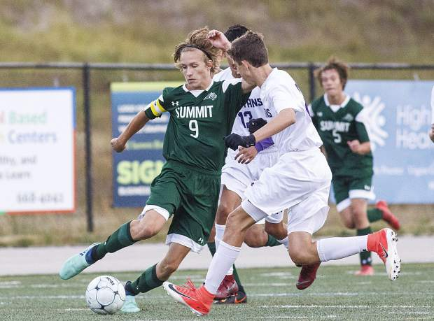 Summit High School senior midfielder Evan Wolfson dribbles the ball during the game against Salida High School on Thursday at Tiger Stadium in Breckenridge. Summit won 2-0.