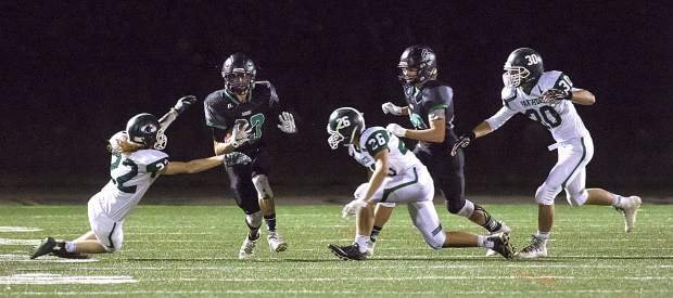 Summit High School football competes against Woodland Park on Friday at Tiger Stadium in Breckenridge.