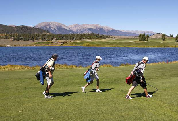 Members of the Summit High School golf team walk between shots during their own Keystone Ranch Golf Invitational tournament at the Keystone Ranch Golf Course on Thursday.