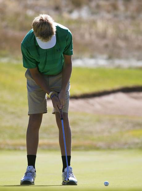 Summit High School golfer Tyler Nakos putts the ball during the team's home Keystone Ranch Golf Invitational tournament at the Keystone Ranch Course on Thursday.