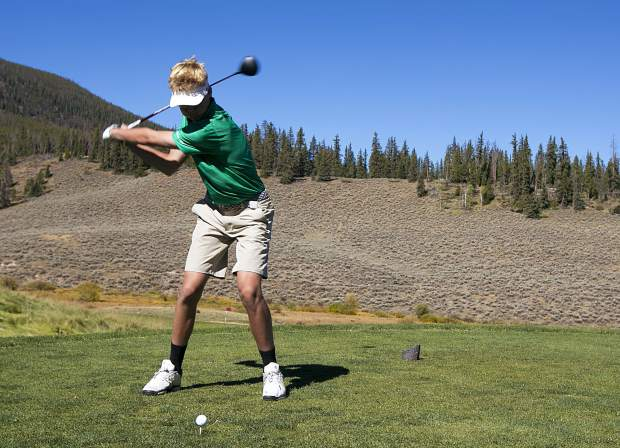 Summit High School golfer Tyler Nakos eyes a tee shot during the Summit High School varsity team's home Keystone Ranch Invitational golf meet at the Keystone Ranch Golf Course on Thursday.