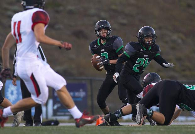 Summit High School senior quarterback Brendan Collins attempts to avoid getting sacked by Elizabeth High School during the Tigers' home game on Friday at Tiger Stadium in Breckenridge.