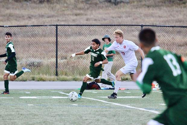 Summit senior playmaker Farid Infante attacks versus the Steamboat Springs defense on Thursday during the Tigers' 3-3 draw versus the Sailors at Tiger Stadium in Breckenridge. Infante contributed one assist.