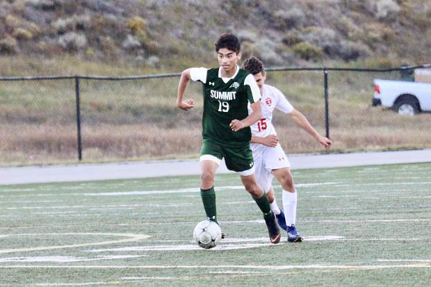 Summit sophomore midfielder Ivan Gutierrez advances the ball during the Tigers' 3-3 draw versus Steamboat Springs on Thursday.