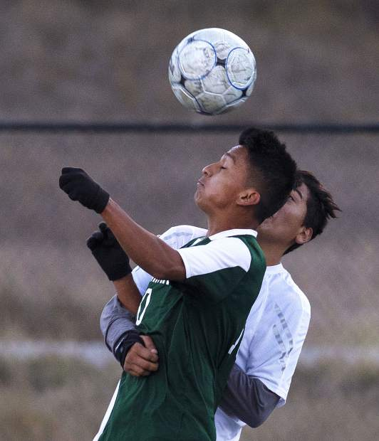 Summit High School senior playmaker Ismael Valenzuela heads the ball during the Tigers' home win against Eagle Valley on Tuesday at Tiger Stadium in Breckenridge.