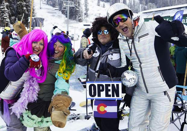 A group in costume cheers during opening day at Arapahoe Basin Ski Area on Friday.