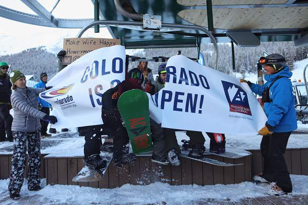 Nate Dogggg and members of the 4G network -- his inner circle of friends that share first-chair honors -- burst through Colorado Ski Country USA's season-opening banner while riding the first chair of the season at Arapahoe Basin Ski Area's Black Mountain Express chairlift on Friday.