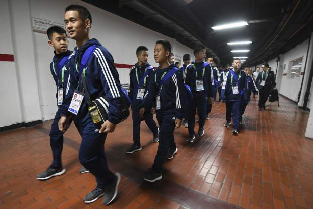Young soccer Thai team Wild Boars tour River Plate's Monumental stadium on the sidelines of the Buenos Aires 2018 Youth Olimpic Games in Buenos Aires, Argentina, Sunday, Oct. 7, 2018. The team made up of 12 boys and their coach, who were rescued from a cave in Thailand, played a friendly match against the youth team of River Plate Sunday.