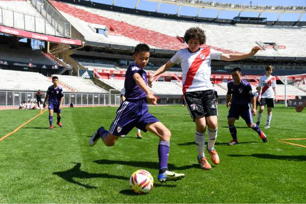 Young soccer Thai team Wild Boars play a friendly match against River Plate youth team at Monumental stadium in Buenos Aires, Argentina on Sunday. The team made up of 12 boys and their coach, who were trapped in a flooded cave for almost three weeks in Thailand, are guests in Buenos Aires during the opening days of the Youth Olympic Summer Games.