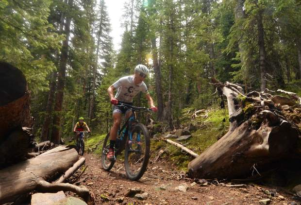 Local XTERRA athlete Jaime Brede barrels through the first section on Trail of Tears in Breckenridge.
