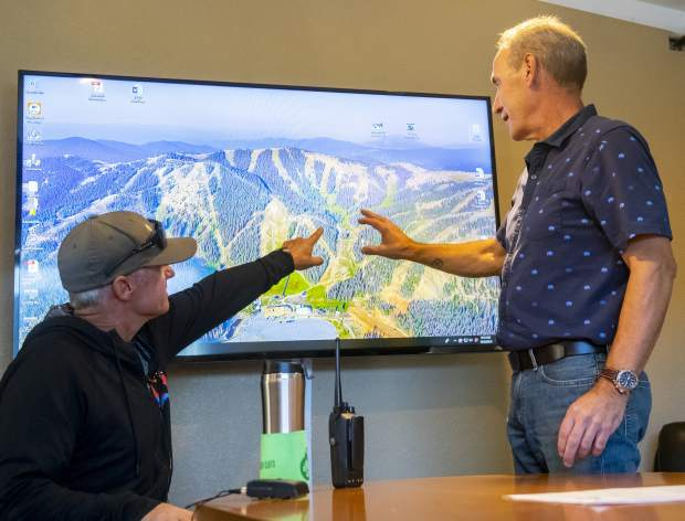 Scott Pressly, vice president of mountain operations, left, and Randy Stroud, general manager/chief operating officer of Monarch Mountain point out the areas of standing trees killed by spruce beetles on Wednesday, Sept. 26, 2018 in Monarch Mountain, Colo. (Dougal Brownlie/The Gazette via AP)