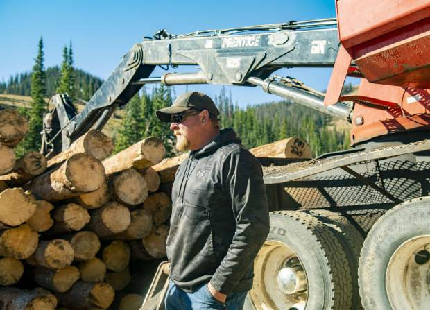 Owner of Salida's CRS Timber Products, Shawn Cheeseman talks about the effects that the spruce beetles have had on portions of the trees on Wednesday, Sept. 26, 2018 in Monarch Mountain, Colo. (Dougal Brownlie/The Gazette via AP)
