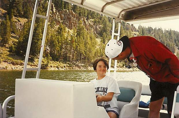 A young Susan Gilmore wears a Rockies shirt while manning the family boat here in her home state of Colorado in the 1990s.