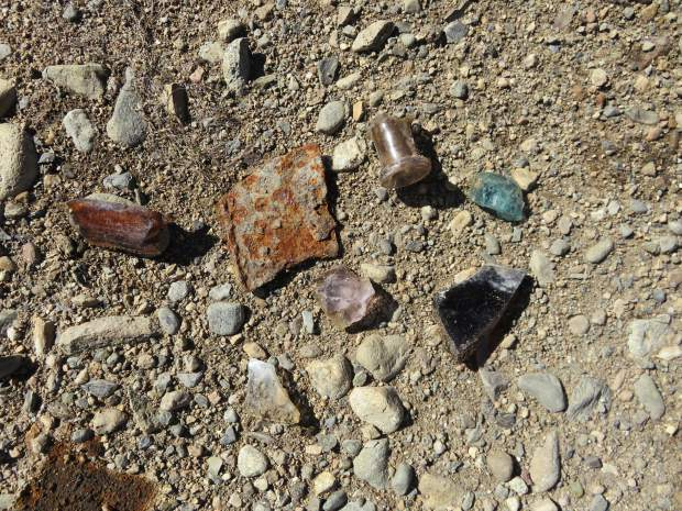 Pieces of Glass Bottles and Bits of Metal. Glass and metal fragments litter the site where once stood a variety of railroad facilities.
