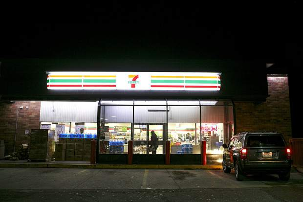 Jack Mathews delivers the Summit Daily News at a Silverthorne 7-Eleven in the early hours of Thursday, Oct. 11.