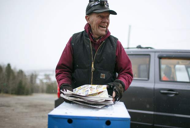 Jack Mathews delivers the day's edition in the Summit Daily News' newspaper vending box in the early hours of Thursday, Oct. 11, north of Silverthorne.
