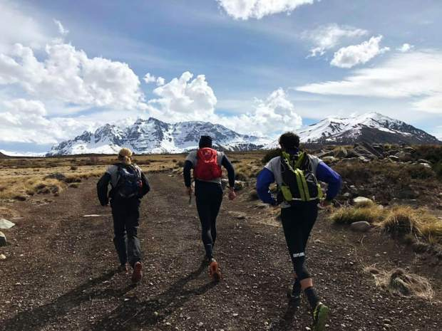 Summit County local Olof Hedberg and members of his Adventure Medical Kits team race by foot during his team's