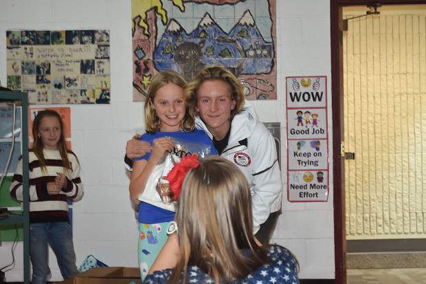 Olympic gold-medal winning snowboarder Red Gerard poses for a photo with a Frisco Elementary School student while his younger sister Asher Gerard's third-grade teacher, Whitney Smith, takes a photo during Red Gerard's return to his former school on Tuesday afternoon.