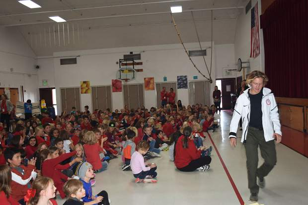 Decked out in myriad shades of red, Frisco Elementary School students cheer on former Frisco Elementary student and Olympic gold-medal winning snowboarder Red Gerard during his speech at his former school Thursday afternoon.