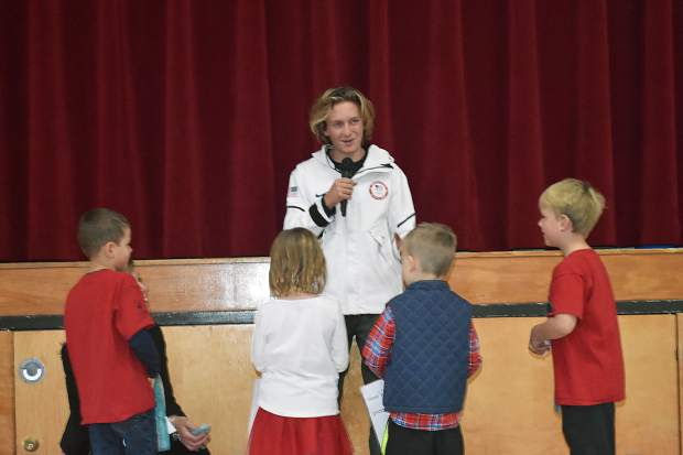 Olympic gold-medal winning snowboarder Red Gerard responds to questions from Frisco Elementary School students during his return to his former school on Tuesday afternoon.