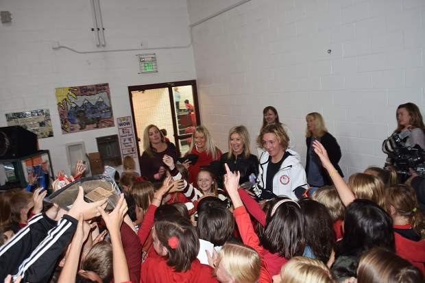 Frisco Elementary School students hold out their hands for giveaways and mob Olympic gold-medal winning snowboarder Red Gerard during Gerard's return to his old school, Frisco Elementary, on Tuesday afternoon.
