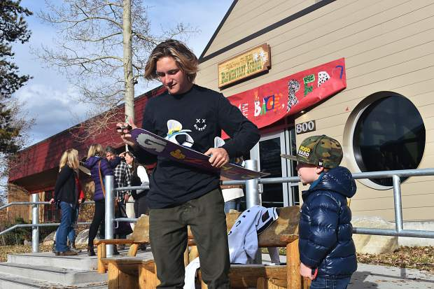 Eighty-eight minutes after the event honoring his return to his old school, Frisco Elementary, began, Olympic gold-medal winning snowboarder Red Gerard signs his final autograph of the day, for young Summit County local Sammy Sherburne.
