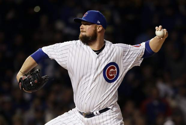Chicago Cubs starting pitcher Jon Lester throws against the Colorado Rockies during the first inning of the National League wild-card playoff baseball game Tuesday, Oct. 2, 2018, in Chicago.