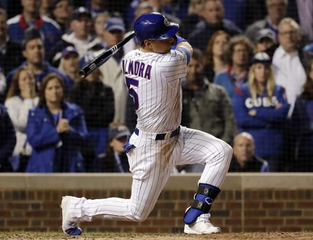 The Chicago Cubs' Albert Almora Jr., strikes out swinging during the 13th inning of the National League wild-card playoff baseball game against the Colorado Rockies on Tuesday in Chicago. The Rockies won 2-1.