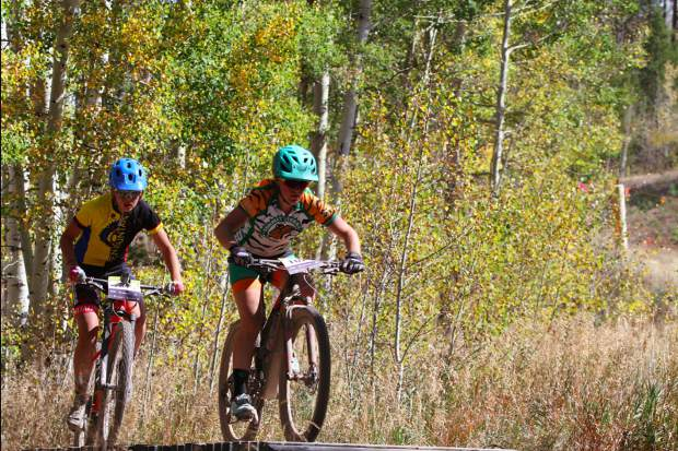 Summit Tigers sophomore mountain biker Tai-Lee Smith, right, rides during last weekend's varsity girls race at the state championship event at the Durango Mesa. Smith earned Summit its most individual points on the weekend with her fifth-place finish.