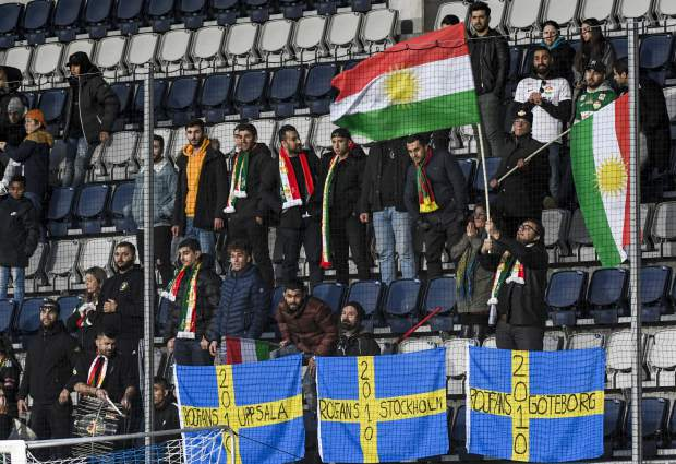 Dalkurd's soccer fans wave Kurdish flags, top, and Swedish flags below, in the stands during the Swedish League soccer match on Saturday between Dalkurd and Orebro at Gavlevallen soccer field in Gavle, Sweden. The 14-year journey of the soccer team known as Dalkurd began as a social project to get misbehaving kids off the street in a rural town in central Sweden. Now, it has grown into a top-flight squad that has given the Kurdish minority - scattered and ravaged by war - something to cherish as its own.
