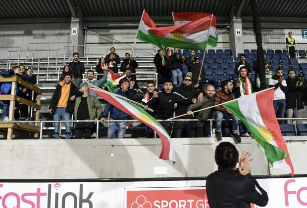 Dalkurd's soccer fans wave Kurdish flags in the stands during the Swedish League soccer match on Saturday between Dalkurd and Orebro at Gavlevallen soccer field in Gavle, Sweden. The 14-year journey of the soccer team known as Dalkurd began as a social project to get misbehaving kids off the street in a rural town in central Sweden. Now, it has grown into a top-flight squad that has given the Kurdish minority - scattered and ravaged by war - something to cherish as its own.