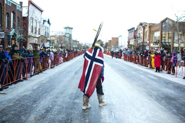 Colorado Ski and Snowboard Hall of Famer C.J. Mueller, who was the first man to ski at 130 mph, walks along the Ullr Fest Parade Thursday, Jan. 11, on Main Street in Breckenridge.