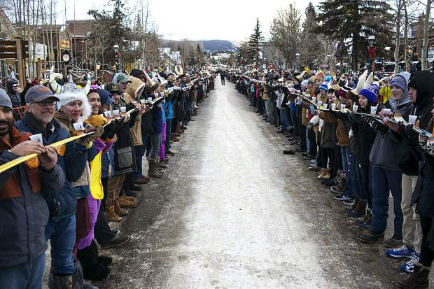 Participants take a ski shot during the Ullr Fest Thursday, Jan. 11, on Main Street in Breckenridge. The world's largest ski shot record was broken with 1266 people with 422 skis at 2128.3 feet in length.