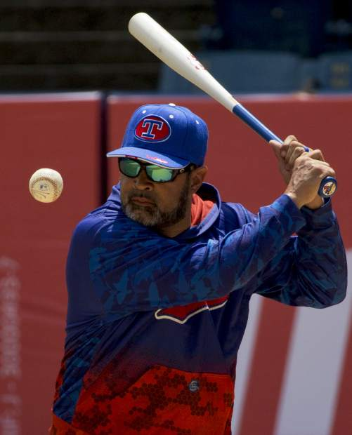 Oswaldo Guillen, coach of Tiburones de la Guaira, practices batting prior to the season's opening game between Leones de Caracas and Tiburones de la Guaira in Caracas, Venezuela on Friday. The former All-Star shortstop known better as