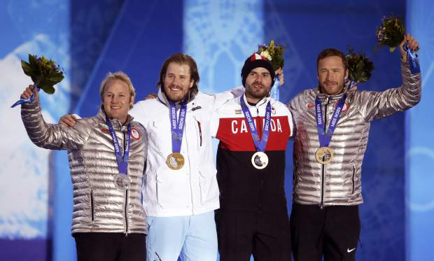 In this February 2014 file photo, men's super-G medalists, from left; the United States' Andrew Weibrecht, silver, Norway's Kjetil Jansrud, gold, and Canada's Jan Hudec and the United States' Bode Miller, who tied for the bronze, pose with their medals at the 2014 Winter Olympics in Sochi, Russia.