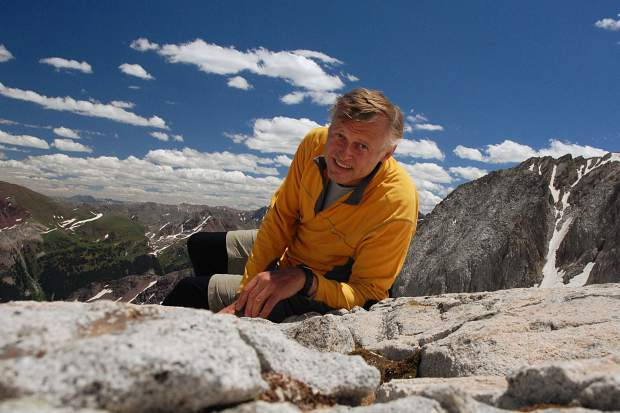 Kim Fenske of Copper Mountain sits near the 14,092-foot summit of Snowmass Mountain